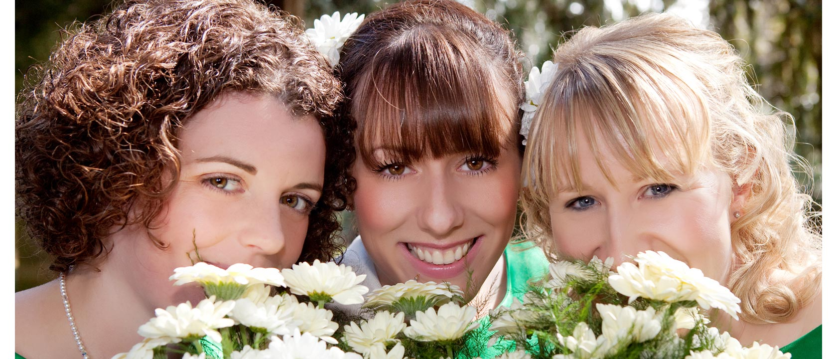 Two lovely bridesmaids and their stunning bride.