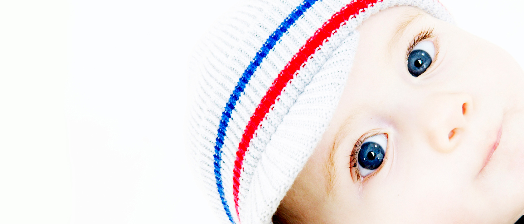 Beautiful photography of a baby staring directly at the camera