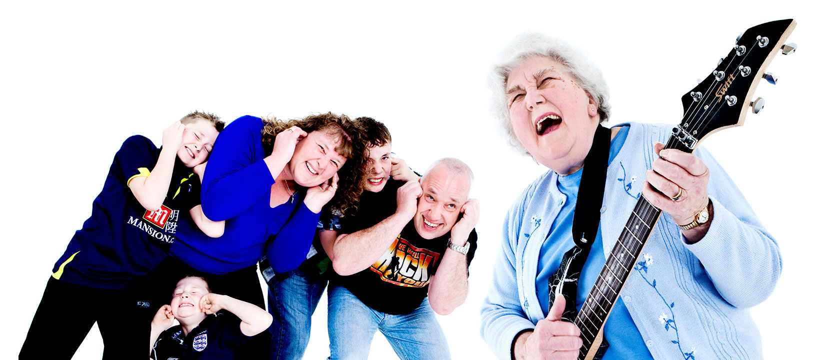 Grandma rocking it on the guitar while the family cowers from the noise